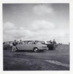 A photo of Dad's Austin on a family outing with cousins. You can see Jim is peeking through the back seat window.