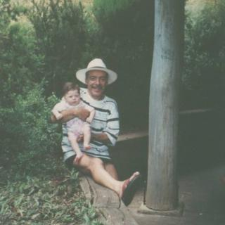 Dad proudly holding his first granddaughter Gisella at her first ever New Year's Day bbq at Silvan Reservoir Park.