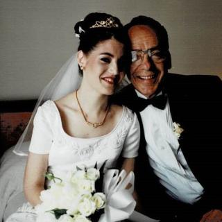 Dad and my sister Linda sharing a precious moment on her Wedding Day. It's 4th March, 2000.