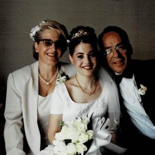 My sister Linda on her Wedding Day sitting with Mum and Dad on their bed. It's 4th March, 2000.