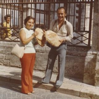 Dad and his niece Angela admiring and smelling this amazing bread in front of St Michele.