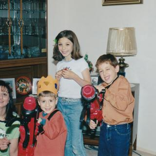 Dad took this memorable photo of Gisella, Sam and Luke receiving gifts from Zia Vicki Christmas 2003.