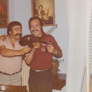 Dad went to visit his long time friend Giovanni while in Italy. They looked so happy playing music and comparing their moustaches.