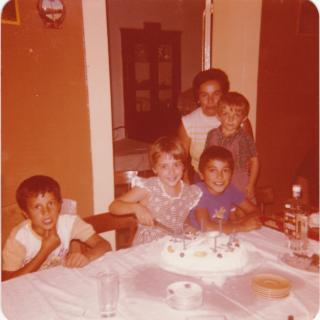 Dad taking this memorable picture of me cutting my 8th birthday cake and making my special wish in Nonna's house.