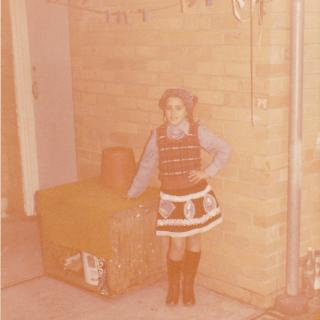 Here I am posing in front of our awesome room that was attached to our garage. It was International Day at Greenslopes and Mum had dressed me up as a Calabrese girl. I think I am '10' as there is a '79' painted on the bricks?