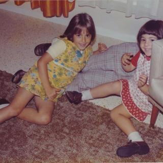My sister Linda and I play fighting with our brother Frank which we loved to do. You can notice that our couch is not there so it's obviously in for repair thanks to me. Dad must of developed these photo's in Bitritto as it's stamped July, 77 in Italian.