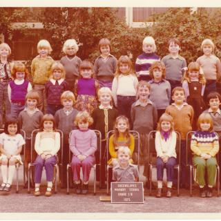 Dad and Mum always bought our school photos'. I'm in the front row, second on the left.  Judging by this photo, the colour purple was very popular in 1975.