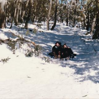 Jim and I tobogganing down the mountain.