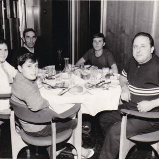 A precious photo of Nonno Salvatore, Dad, Ellen, Sam and Frank eating on board the ship on the way to Italy. Nonno dated it April, 1970.