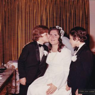 It's March 1974 and Ellen is getting ready on her Wedding day with Nick giving her a kiss.