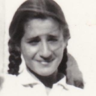 Mum loved putting her hair in plaits. She was 13yrs old when this photo was taken.