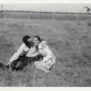 Dad trying to steal a kiss from Mum while they enjoyed a day out at the Lang Lang Rodeo Festival. It's Easter 1966 and Mum is pregnant with my brother Frank.