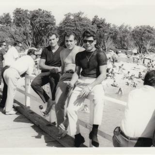 Dad enjoying the sun with his friends Giuliano and Sam on the Frankston Beach Pier. It's January, 1965 and the Australia Day long weekend.