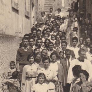Mum at the Madonna Delle Grazie Procession in Cosenza, Calabria in May 1958. She is the one in the middle of the fourth row with her head scarf on.