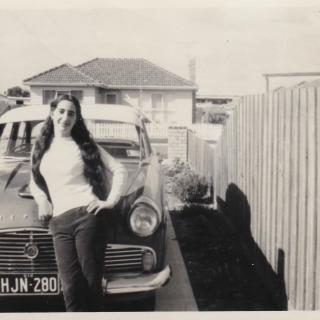 Mum is '17' in this photo and leaning on a Ford Zephyr.