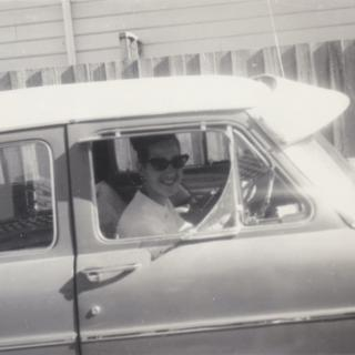 A precious and rare photo of my beautiful Mum in the driver's seat. It's 1963 and she is in the driveway of her Haresta Avenue home.