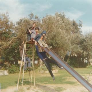 A precious photo from the early 70's of fun times at the park near home. Jim is about to slide down with Nick right at the top and Frank is underneath it trying to grab their legs.