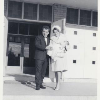 Dad and Mum once again at the top of the steps of St Mary's Church, Dandenong in 1967, but this time they are holding their godchild.