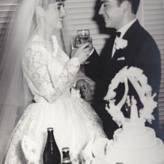 Mum and Dad happily married and making their first toast together. Dad smitten by mum closed his eyes for a second.