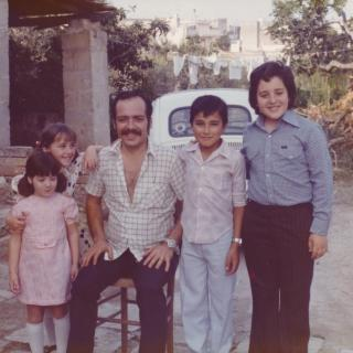 A memorable photo of us in Dad's childhood backyard.