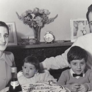 A memorable photo of Mum, Dad and Frank celebrating my 1st ever Birthday.