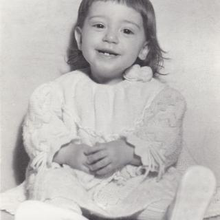 A precious 1st Birthday photo taken of me on our special couch.