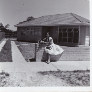 My beautiful Mum aged 17 sitting on her new fence.  It's 1963 and they have just moved to there new home at 30 Haresta Avenue, Dandenong.
