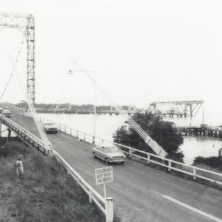 An image I found of the old suspension bridge that Mum had crossed over to get to Cowes. The new concrete bridge being built next to it was officially opened in 1969, the year I was born.
